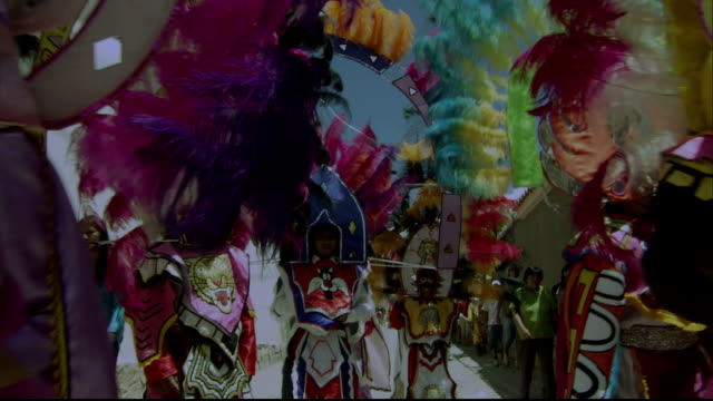 carnival dancers wear elaborate headdresses and costumes at a festival in humahuaca. available in hd. - 頭飾り点の映像素材/bロール
