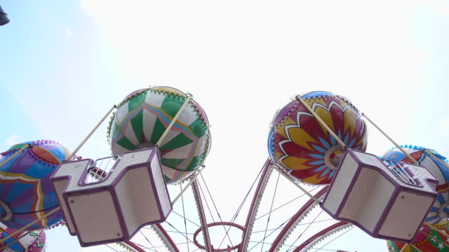 carnival fair swing ride at midway - roundabout stock videos & royalty-free footage