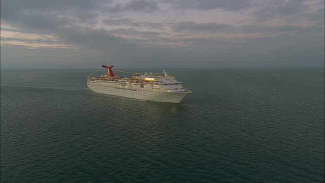 AERIAL WS ZI Carnival Imagination cruise ship floating in sea at sunrise / Key West, Florida, USA