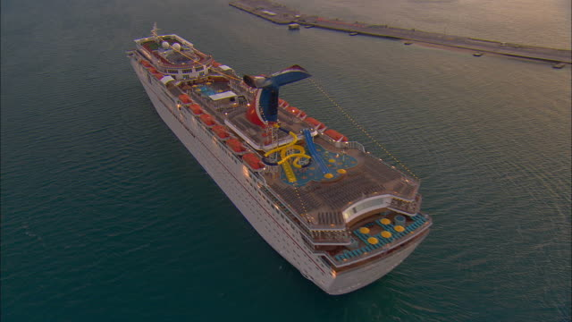 AERIAL WS ZI CU Carnival Imagination cruise ship floating in sea with view over deck / Key West, Florida, USA