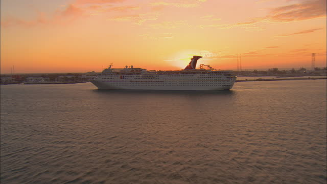 AERIAL WS Carnival Imagination cruise ship floating near port at sunrise / Key West, Florida, USA