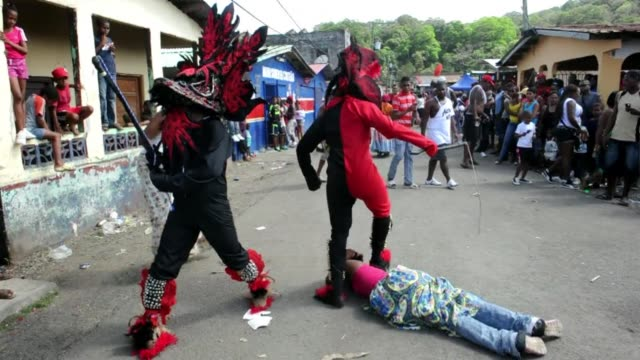 carnival in panamas black community is celebrated with an unusual tradition dating back to colonial times participants dress up as devils... - colon stock videos & royalty-free footage