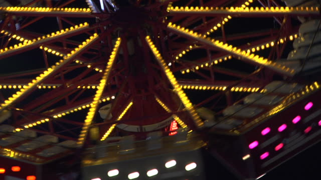 carnival ride spinner at night hd - school fete stock videos and b-roll footage