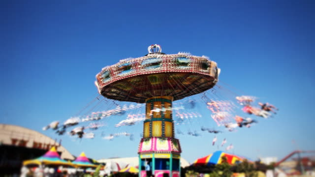 carnival swing ride at midway (time-lapse) - roundabout stock videos and b-roll footage