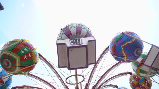 carnival swing ride at midway - roundabout stock videos & royalty-free footage