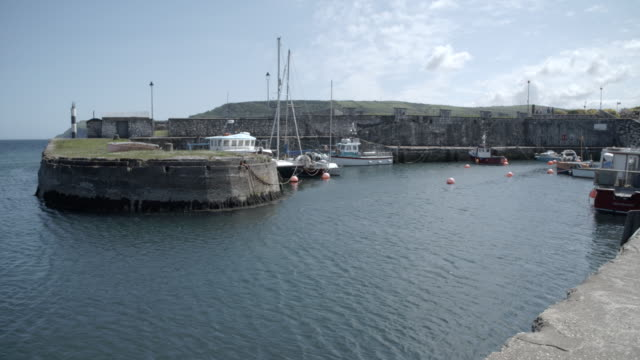 carnlough harbour / ballygally, northern ireland - geographical locations stock videos & royalty-free footage