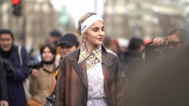 caro daur wears a bandanna a long coat a fringed bag a dress leggings shoes a gingham shirt outside miu miu during paris fashion week womenswear... - gingham stock videos & royalty-free footage