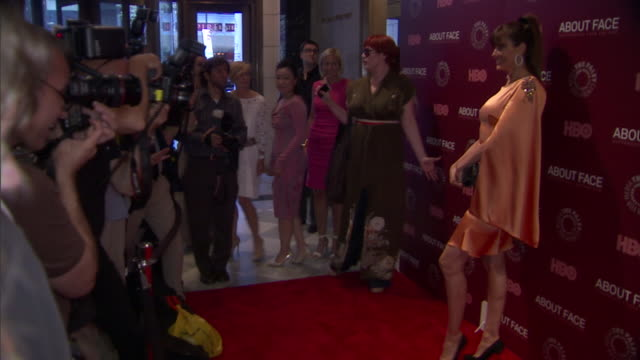 Carol Alt posing for paparazzi on the red carpet at the Paley Center for Media