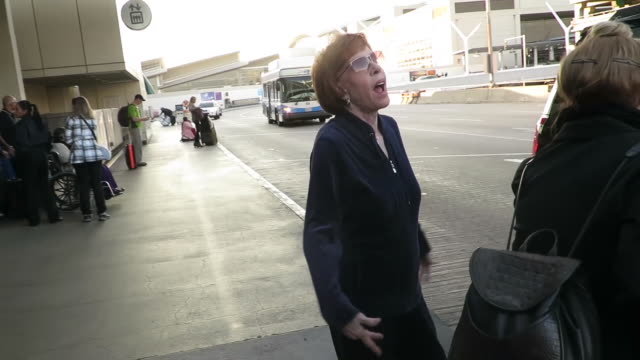 Carol Burnett is asked how she stays so beautiful as she leaves Los Angeles International Airport in a black SUV
