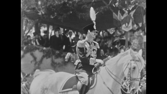carol ii king of romania on horseback soldiers marching in line w/ sword by side soldiers in open square standing then sitting - recreational horse riding stock videos and b-roll footage