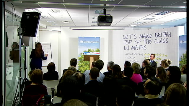 vídeos y material grabado en eventos de stock de carol vorderman and david cameron speak at press conference more of vorderman working out mathematical problem at white board / david cameron mp... - carol vorderman