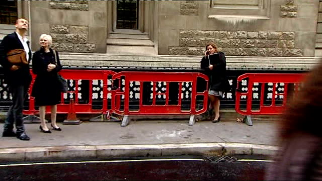 carole caplin wins libel damages from daily mail; england: london: royal courts of justice: ext carole caplin standing in street outside court - 文書による名誉棄損点の映像素材/bロール