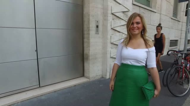 Carolina Ogliario wearing a white tshirt and Medusa bag and vintage skirt during Milan Men's Fashion Week SS17 on June 19 2016 in Milan Italy