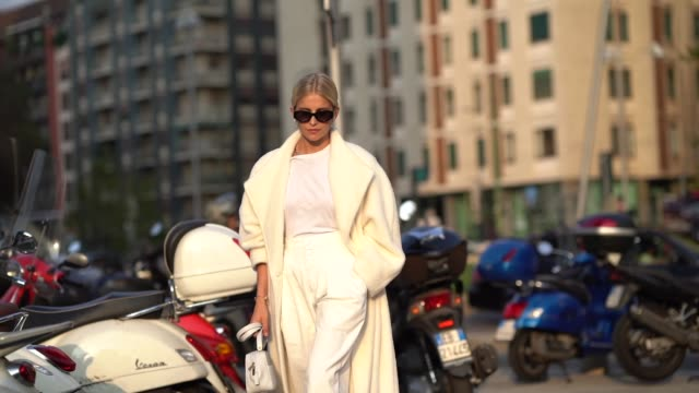 caroline daur a white coat, a white bag, a white t-shirt, pants, heels shoes, outside the alberta ferretti show during milan fashion week... - street style stock videos & royalty-free footage