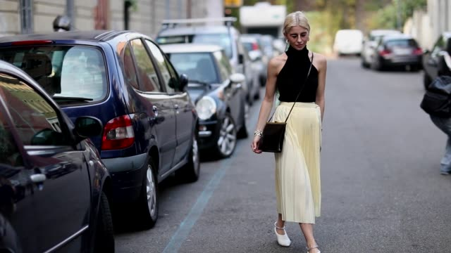 caroline daur wearing yellow skirt, black top, scarf in her hair is seen outside jil sander during milan fashion week spring/summer 2019 on september... - street style stock videos & royalty-free footage
