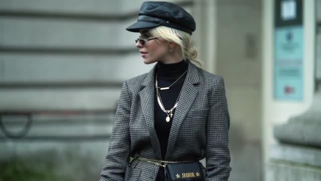 Caroline Daur wears a beret hat a blazer jacket a skirt a Dior bag outside Dior during Paris Fashion Week Menswear Fall Winter 20182019 on January 20...