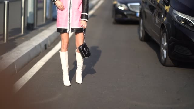 Caroline Daur wears a beret hat a pink jacket white boots during Milan Menswear Fashion week Fall/Winter 2018/19 on January 14 2018 in Milan Italy