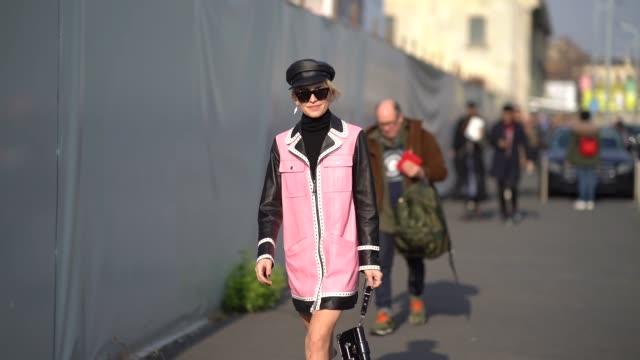 Caroline Daur wears a beret hat and a pink jacket during Milan Menswear Fashion week Fall/Winter 2018/19 on January 14 2018 in Milan Italy