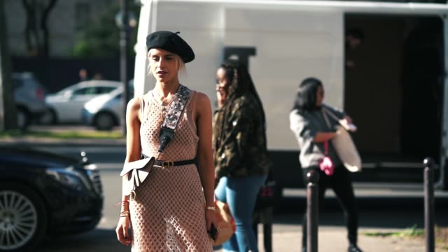 caroline daur wears a black beret hat a dior saddle pink bag a flower print shoulder strap a pink fishnet dress a cd dior belt earrings outside dior... - fishnet stock videos and b-roll footage