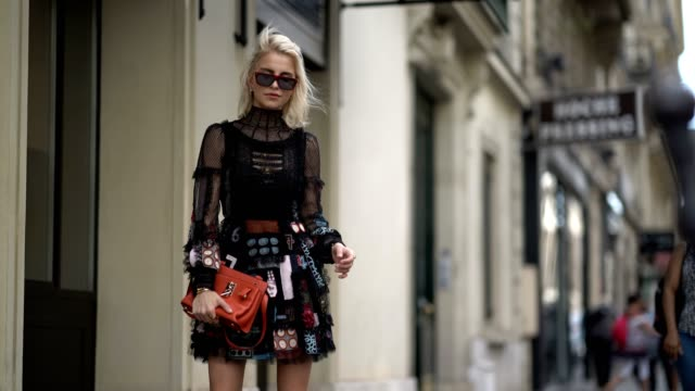 stockvideo's en b-roll-footage met caroline daur wears a black lace mesh dress and an orange bag outside the valentino show during paris fashion week haute couture fall/winter 20172018... - week