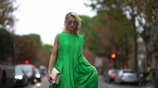 caroline daur wears a green dress, outside valentino, during paris fashion week womenswear spring/summer 2018, on october 1, 2017 in paris, france. - valentino designer label stock videos & royalty-free footage