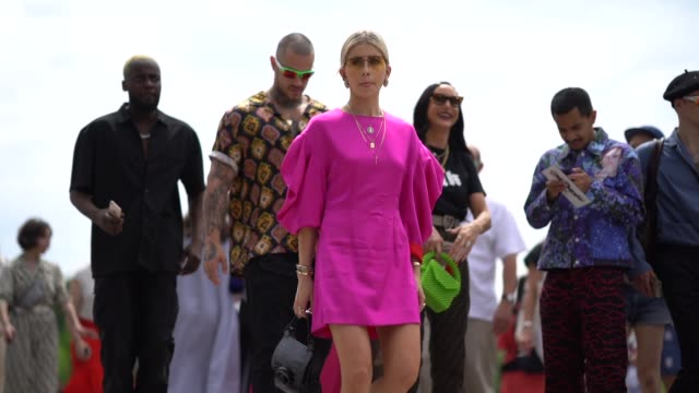 caroline daur wears a pink dress with ruffled sleeves, a black bag, a necklace, yellow sunglasses, a bracelet, outside kenzo, during paris fashion... - street style stock videos & royalty-free footage