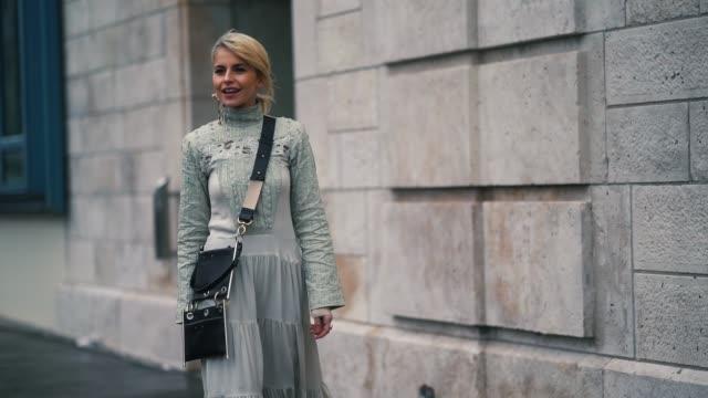 caroline daur wears a white dress, during paris fashion week womenswear fall/winter 2018/2019, on march 1, 2018 in paris, france. - 白のドレス点の映像素材/bロール
