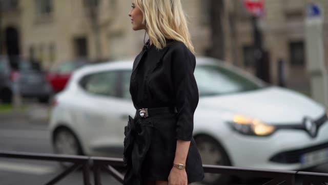 caroline daur wears earrings a black dress a black miu miu belt outside miu miu during paris fashion week womenswear fall/winter 2019/2020 on march... - black dress stock videos & royalty-free footage