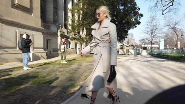 caroline daur wears mirror sunglasses, a gray long wool coat, a small bag, fringed high heeled shoes, outside elie saab, during paris fashion week -... - paris fashion week - haute couture spring/summer 2020点の映像素材/bロール