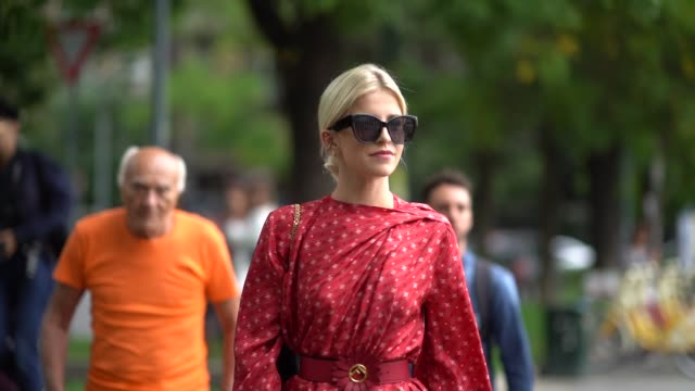 caroline daur wears sunglasses a red dress with printed fendi logos a fendi black bag a belt red shiny high heeled boots outside the fendi show... - spring summer collection stock videos & royalty-free footage