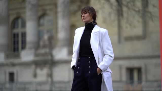 caroline de maigret wears a white coat flare pants with buttons a black turtleneck top outside chanel during paris fashion week haute couture... - turtleneck stock videos & royalty-free footage