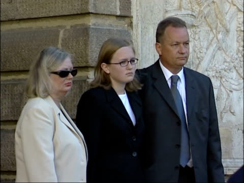 trial opens france rennes sue and john dickinson standing with their daughter jennifer for photocall pan as into court building for trial of... - rennes frankreich stock-videos und b-roll-filmmaterial