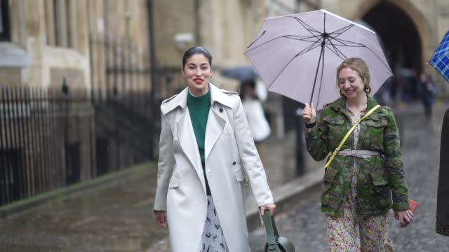 caroline issa wears a green pullover a white long trench coat a dress black and brown pointy snake pattern printed boots during london fashion week... - brown stock videos & royalty-free footage