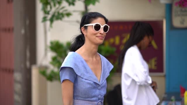 8aa4043596dd Caroline Issa wears sunglasses a blue dress outside Acne Studios during  Paris Fashion Week Womenswear Fall