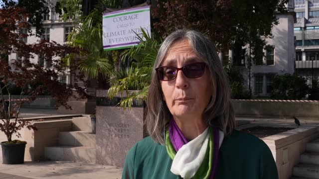 """caroline lucas mp and helen pankhurst join activists in """"green bombing"""" the statue of millicent fawcett in parliament square to highlight the climate... - connection stock videos & royalty-free footage"""