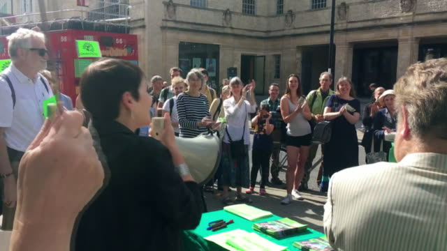 caroline lucas posing with green party campaigners on the european election trail - green party stock videos and b-roll footage