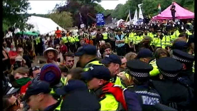 Caroline Lucas to continue fracking campaign after being cleared of protest charges R19081311 / Balcombe Protesters and police officers scuffling at...