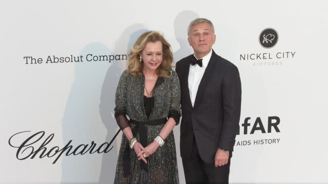 Caroline Scheufele and Christoph Waltz at the amfAR Cannes Gala 2019 Arrivals at Hotel du CapEdenRoc on May 23 2019 in Cap d'Antibes France