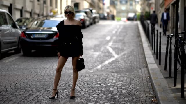Caroline Vreeland wears a black offshoulder dress outside the Zuhair Murad show during Paris Fashion Week Haute Couture Fall/Winter 20172018 on July...