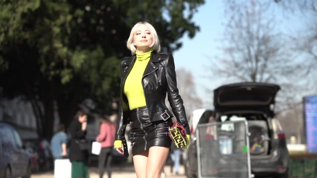 caroline vreeland wears a neon yellow turtleneck a black leather jacket a skirt black shoes a fendi bag outside unravel project during paris fashion... - turtleneck stock videos & royalty-free footage
