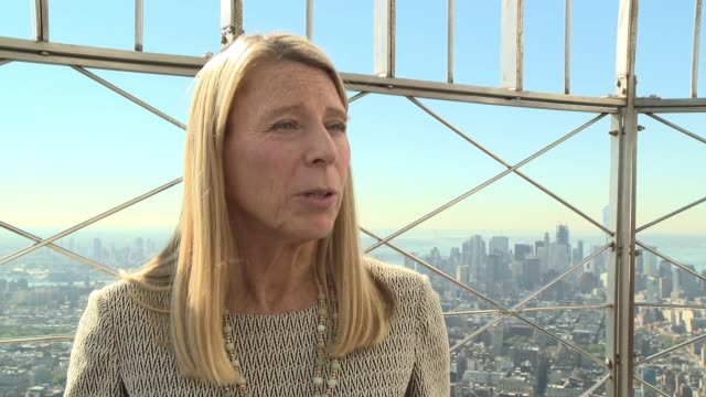 INTERVIEW Carolyn Miles Save the Children's president CEO on why they are lighting the Empire State Building red today on the harms that befall girls...
