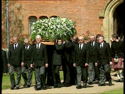 caron keating funeral; itn england: kent: ext cilla black and cliff richard along at funeral of tv presenter caron keating coffin carried along by... - gloria hunniford stock-videos und b-roll-filmmaterial