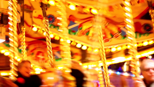 carousel and amusement park with kids - fairground stock videos and b-roll footage