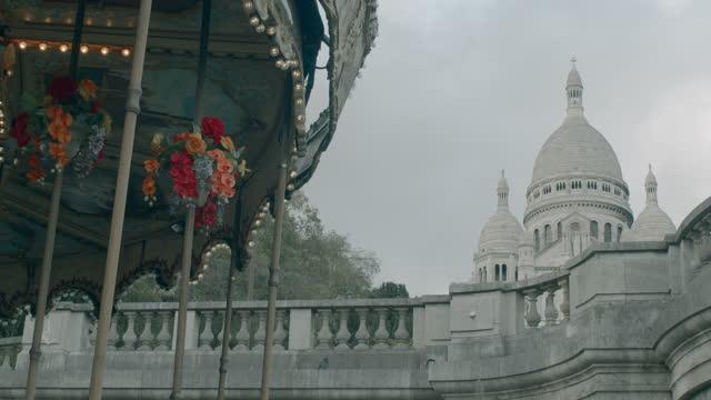 carousel and basilique du sacre coeur - montmartre, paris - basilica stock videos & royalty-free footage
