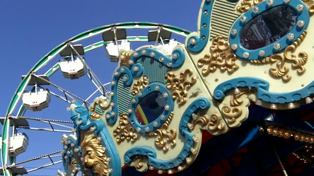 carousel and ferris wheel - carousel stock videos and b-roll footage