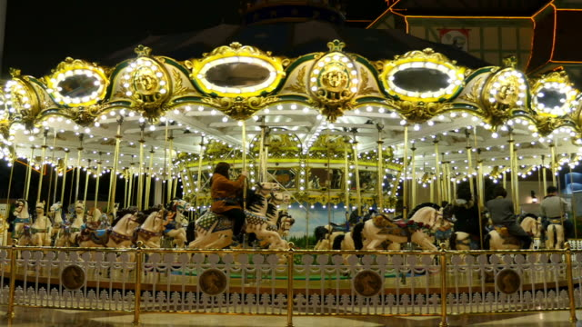 carousel at amusement park - roundabout stock videos & royalty-free footage