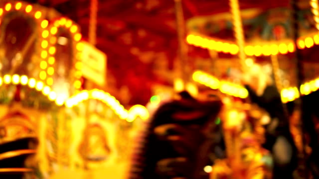 carousel, circus and amusement park with kids - roundabout stock videos & royalty-free footage