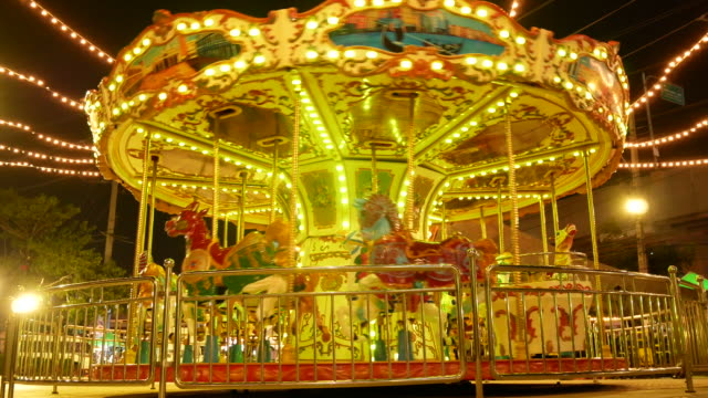 carousel during the night. - roundabout stock videos & royalty-free footage