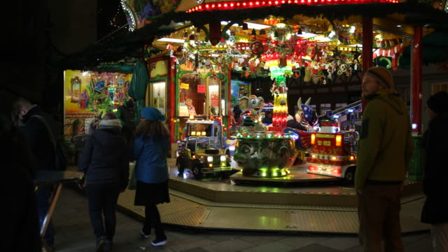 carousel for children at a christmas market with christmas decoration in germany visitors are enjoying arts and crafts and are tasting drinks like... - advent calendar stock videos & royalty-free footage
