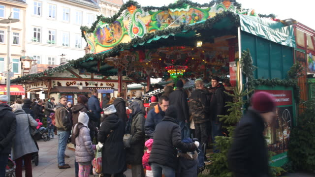 carousel for children at a christmas market with christmas decoration in germany christmas market with christmas decoration in germany visitors are... - advent calendar stock videos & royalty-free footage